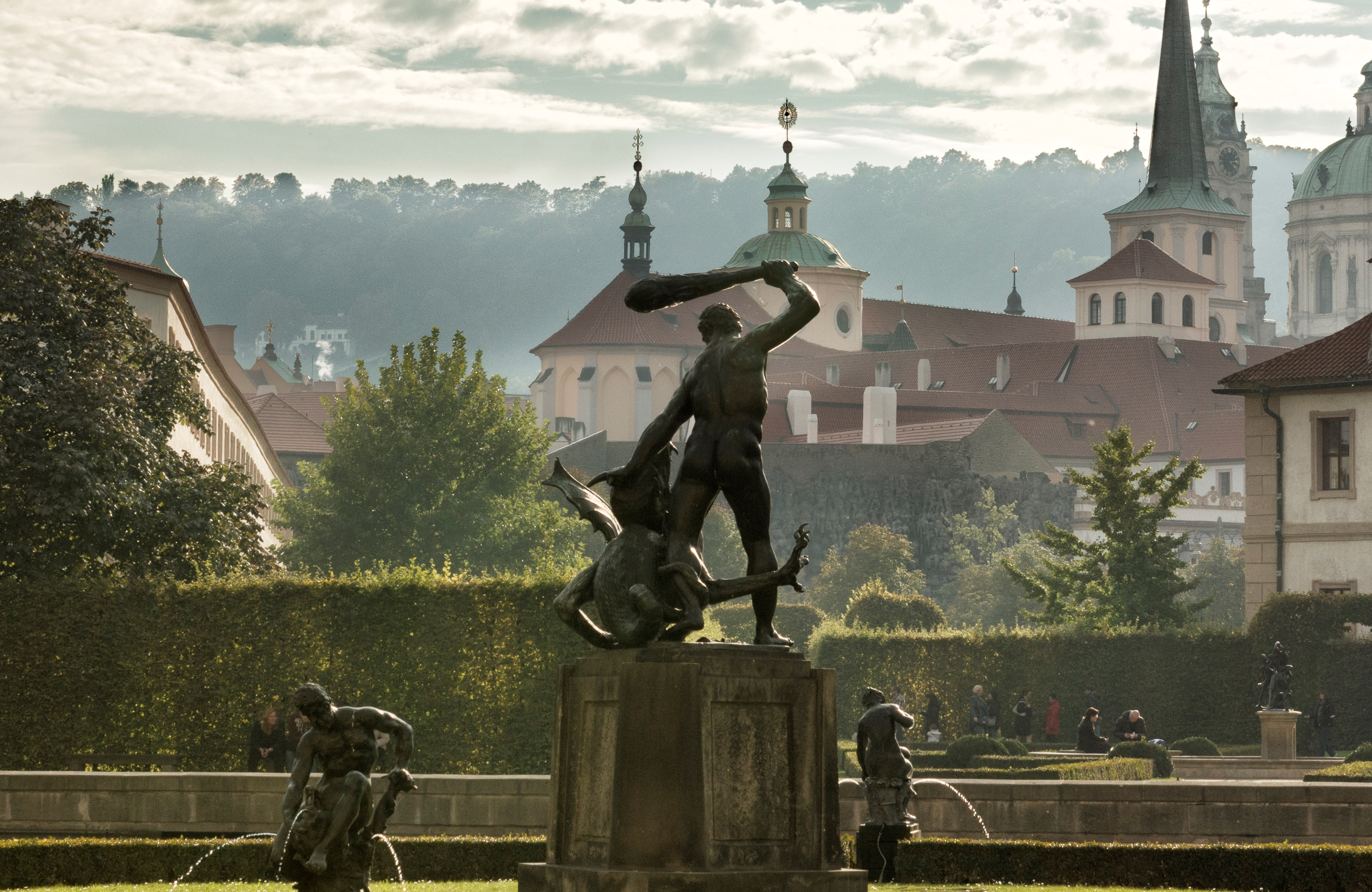 Statue of Hercules and other statues by Adrian de Vries - Prague.eu